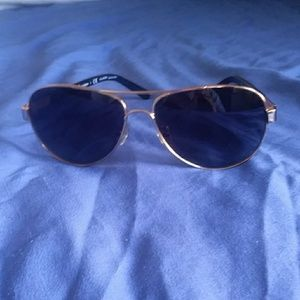 Tory Burch  aviator sunglasses.